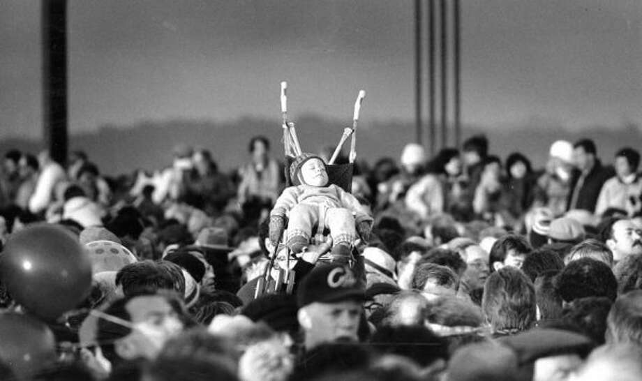 May 24, 1987: Montgomery Calderwood, 1 year old, practicing crowd surfing for a future Pearl Jam concert. This was taken during the 50th anniversary of the Golden Gate Bridge. (Tom Levy / The Chronicle)
