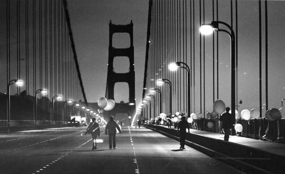 May 24, 1987: Golden Gate Bridge revelers break through barriers and walk on the bridge before the 50th anniversary festivities.  (Gary Fong / The Chronicle)