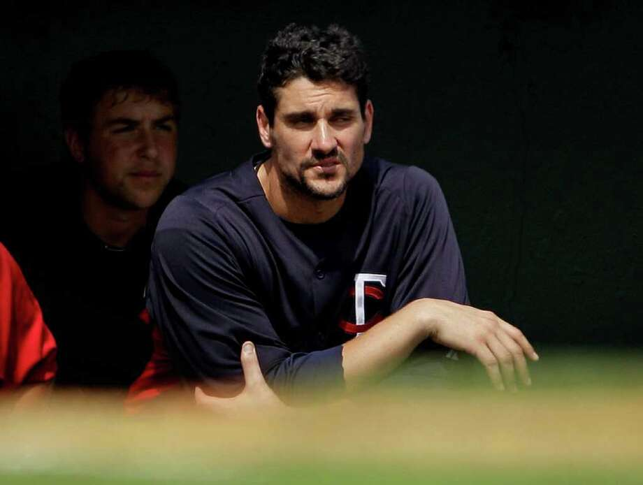 Minnesota Twins starting pitcher Carl Pavano looks on from the dugout in the fourth inning of a spring training baseball game against the Baltimore Orioles, Wednesday, March 7, 2012, in Sarasota, Fla. In his second spring start, Pavano allowed a run and six hits in three innings. In five innings, he has given up three runs and nine hits. Photo: David Goldman, Associated Press / Associated Press
