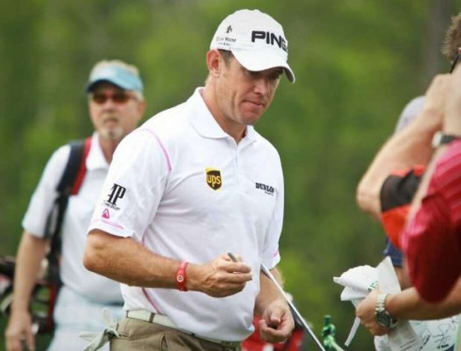 Lee Westwood gives golf fans autographs after completing the ninth hole during the Shell Houston Open's Grand Pro-Am, Wednesday, March 28, 2012, at the Redstone Golf Club in Humble. (Nick De La Torre / Houston Chronicle)