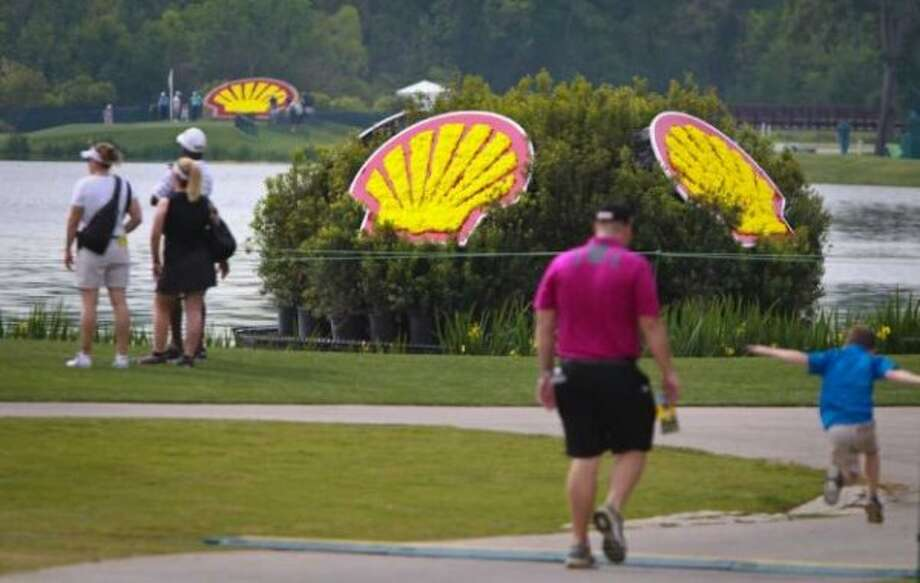 Golf fans and their families walk the grounds of the Redstone Golf Club during the Shell Houston Open practice days, Tuesday, March 27, 2012, in Houston. (Nick De La Torre / Houston Chronicle)