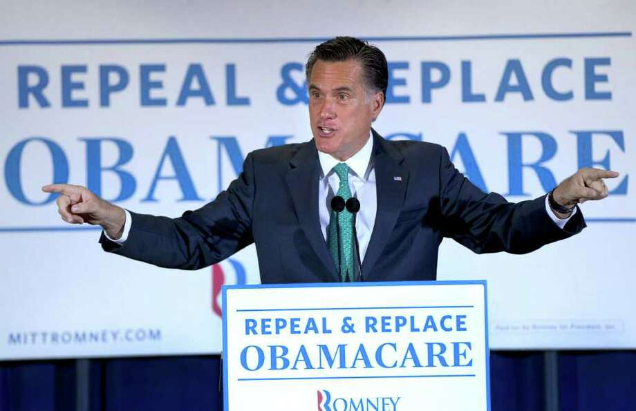 Mitt Romney speaks at NuVasive Inc., a medical device company in San Diego, Calif., Monday. His health care act for the Bay State addressed its 460,000 uninsured residents. Photo: Steven Senne, Associated Press