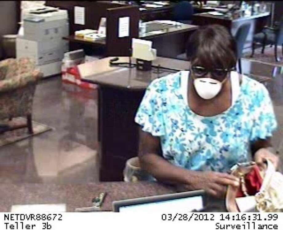 The FBI is searching for a cross-dressing bank robber who struck a Montrose branch Wednesday. Photo: Ho / HC