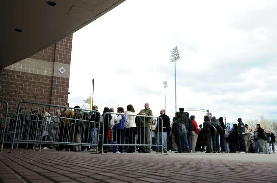 Homeowners line up outside the Webster Bank Arena in Bridgeport Thursday, Mar. 28, 2012 during a mortgage assistance event.  Bank representatives from around the country were on hand to offer mediation. Photo: Autumn Driscoll / Connecticut Post