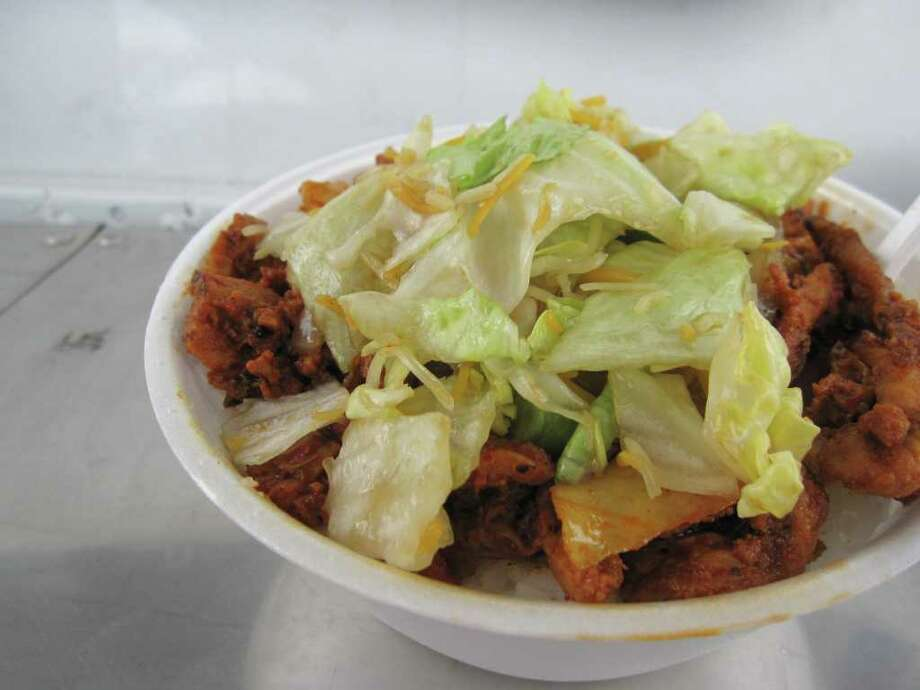 The Dup Bob bowl is dwegi bugogi (spicy pork) served over a bowl of steamed rice and vegetables at Takoriya food truck. Photo: Jessica Elizarraras
