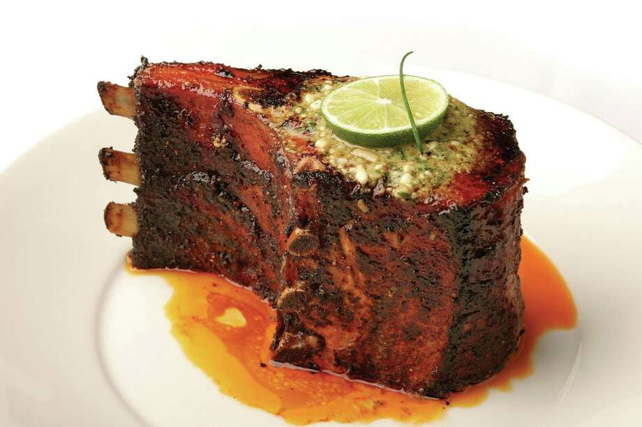 Pork Chop from Perry's Steakhouse. The restaurant will once again offer its famous pork chop Friday lunch for 79 cents Photo: COURTESY PHOTO