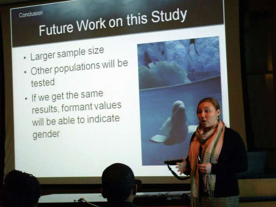 Brooke Davis, a senior at Darien High School, gives a presentation on her original research onbeluga whale vocalizations. She presented her research to a crowd of her peers and mentors in a lecture hall in the UConn Chemistry Building at the Junior Science and Humanities Symposium on March 12. Photo: Contributed Photo