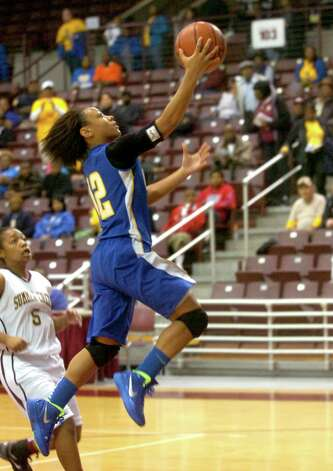 Ozen's Asia Booker goes up for the basket during the game against Summer Creek at the M.O. Campbell Center in Aldine, Friday, February 17, 2012. Tammy McKinley/The Enterprise Photo: TAMMY MCKINLEY
