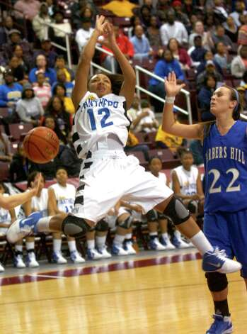 Ozen's Asia Booker loses control of the ball during the shot against Barber's Hill at the Aldine Campbell Center in Houston, Saturday, February 25, 2012. Tammy McKinley/The Enterprise Photo: TAMMY MCKINLEY