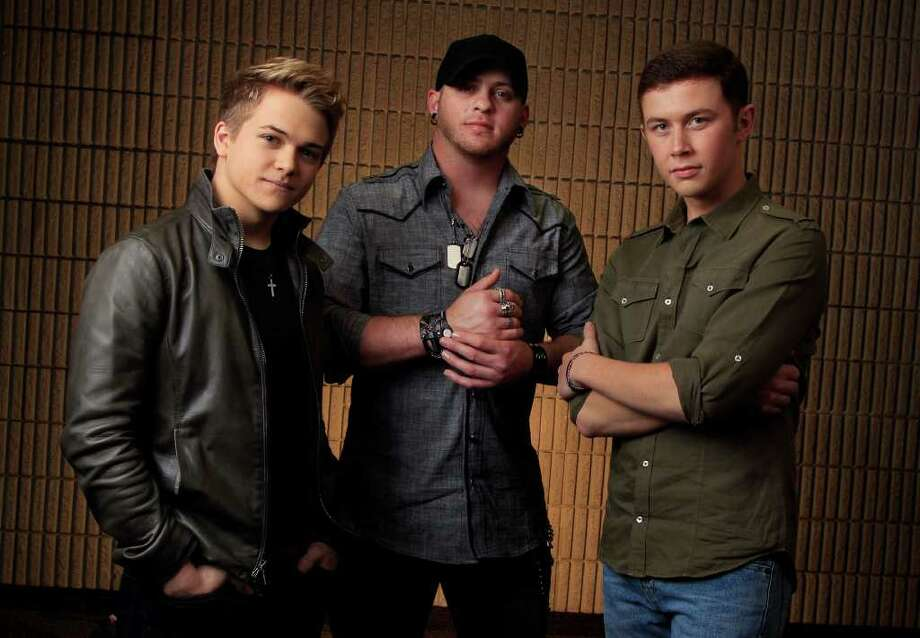 This March 8, 2012 photo shows Hunter Hayes, left, Brantley Gilbert, center, and Scotty McCreery, right, in Nashville, Tenn. The fan-voted top new artist category at the Academy of Country Music Awards features all three. Photo: AP
