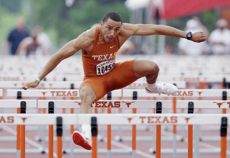 Texas' Isaac Murphy competes in the 110-meter hurdle portion of the  decathlon during the Texas Relays on Thursday in Austin. Photo: AP