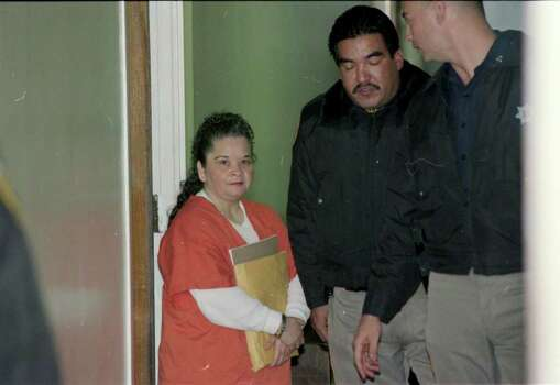 Yolanda Saldivar is led from a holding room  to be taken back to the Harris County Jail and then to prison in Huntsville on Jan. 13, 1997, during an appeal of her conviction in the murder of Tejano singer Selena Quintanilla Perez. Photo: Steve Ueckert, Houston Chronicle / Houston Chronicle