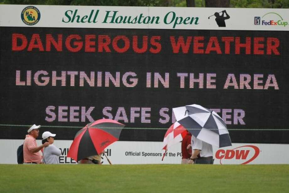 SHO fans and players leave the course to find shelter as rain storms approach.  (Nick De La Torre / Houston Chronicle)