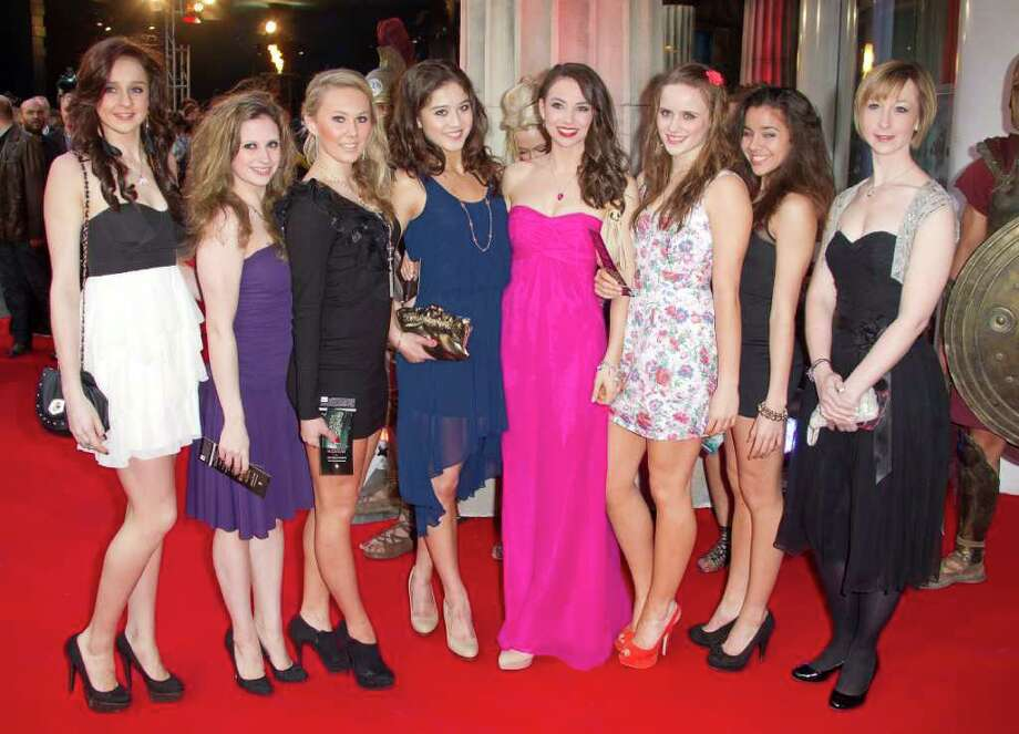 Olympic Coach Sarah Moon, far right, poses with Rythmic Gymnastic dancers as they arrive at the 'Wrath of the Titans' UK premiere at the BFI Southbank in London, Thursday, March 29, 2012. (AP Photo/Joel Ryan) Photo: Joel Ryan, Associated Press / AP