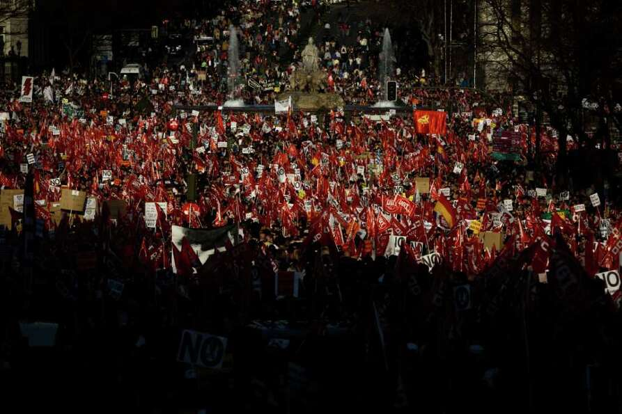Thousands of demonstrators march during a general strike to protest against the government's tough n