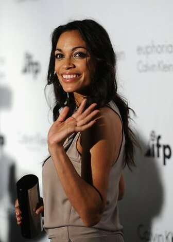 "Rosario Dawson: ""Growing up, a lot of the girls in my school started developing quickly. My mom has a very pronounced bust line and I was a late bloomer. One of my worst memories is getting all dressed up for a school activity and having the girls pick on me because I was flat chested. I was very much a tomboy for a long time."" Dawson told PBS Kids. (Ian Gavan / Getty Images)"