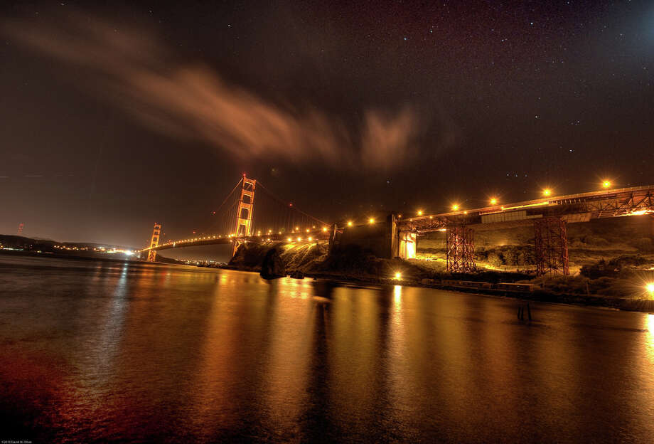 Two suspects remained at large Tuesday after leading law enforcement  officers on a high-speed chase across the Golden Gate Bridge on Monday evening. Photo: Alleno, Alleno / Reader Photo / ©2010 David W. Oliver