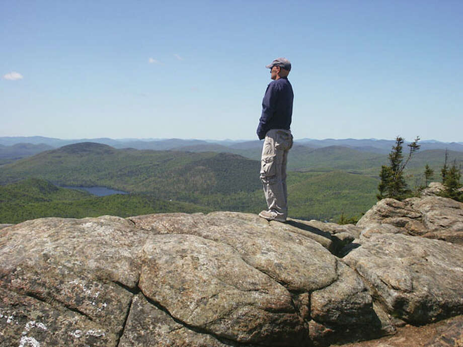 The summit of Crane Mountain provides glorious views of the High Peaks and more. (Photo by Phil Brown/Adirondack Explorer)