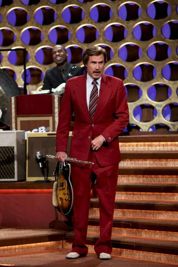 """In this March 28, 2012 photo released by Team Coco, Will Ferrell portrays broadcaster Ron Burgundy during an appearance on """"Conan,"""" in Burbank, Calif.  Ferrell dressed as the popular character from """"Anchorman: The Legend of Ron Burgundy,"""" and after performing a flute solo, he announced that there would be a sequel to the 2004 film. (AP Photo/Team Coco, Meghan Sinclair) Photo: Meghan Sinclair"""
