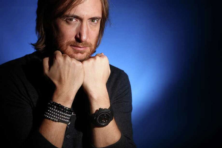 FILE - In this Dec. 8, 2011 file photo, music producer and DJ David Guetta poses for a portrait in New York. Guetta, who is from France, helped bring the electronic sound to America by collaborating with acts like the Black Eyes Peas, Kelly Rowland, Usher, Nicki Minaj, Akon and more. He has two Grammy Awards and six Top 40 hits on the Billboard Hot 100 chart. (AP Photo/Carlo Allegri, file) Photo: Carlo Allegri