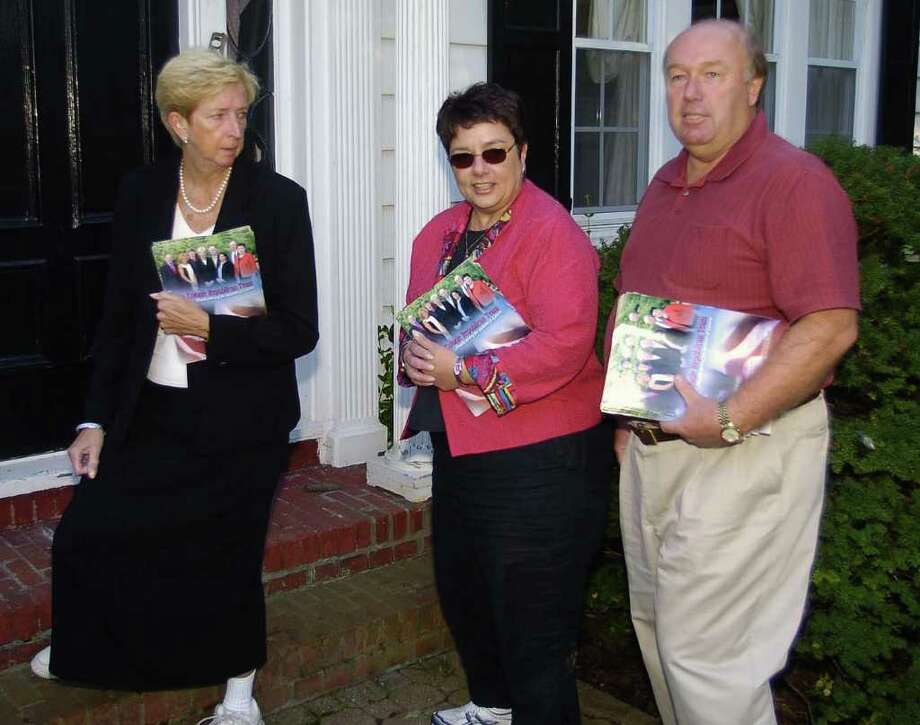 Times Union Photo by James Goolsby-Sept.28,2005-(L. to R.)- Colonie Republican candidates Mary Brizzell, Colonie Town Supervisor. Elizabeth Deltorto, Town Clerk and Brian Hogan, Town Board. Canvass homes in the Town of Colonie. Photo: JAMES GOOLSBY / ALBANY TIMES UNION