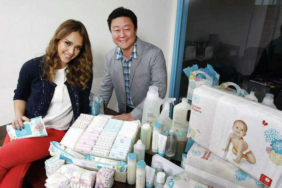 Jessica Alba, left, and Brian Lee, right, pose for a photo on February 1, 2012, at the Santa Monica, California headquarters of Honest.com, a new L.A. tech/retail start-up that sells organic baby products. Photo: Brian Van Der Brug, MCT / Los Angeles Times