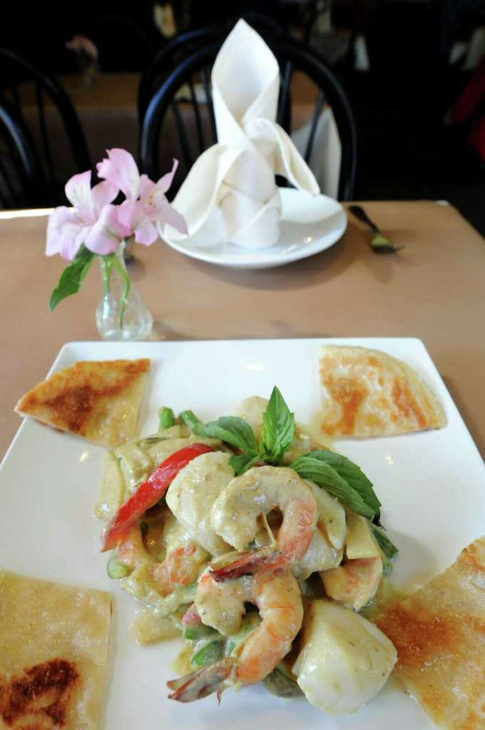 Dried Emeral Curry dish, which is stir-fried shrimp and scallops with string beans, Thai eggplant, bell pepper, bamboo shoots, kachai, basil and green curry paste with coconut milk on Wednesday, March 28, 2012, at Kinnaree Asian Restaurant in Albany, N.Y. (Cindy Schultz / Times Union)
