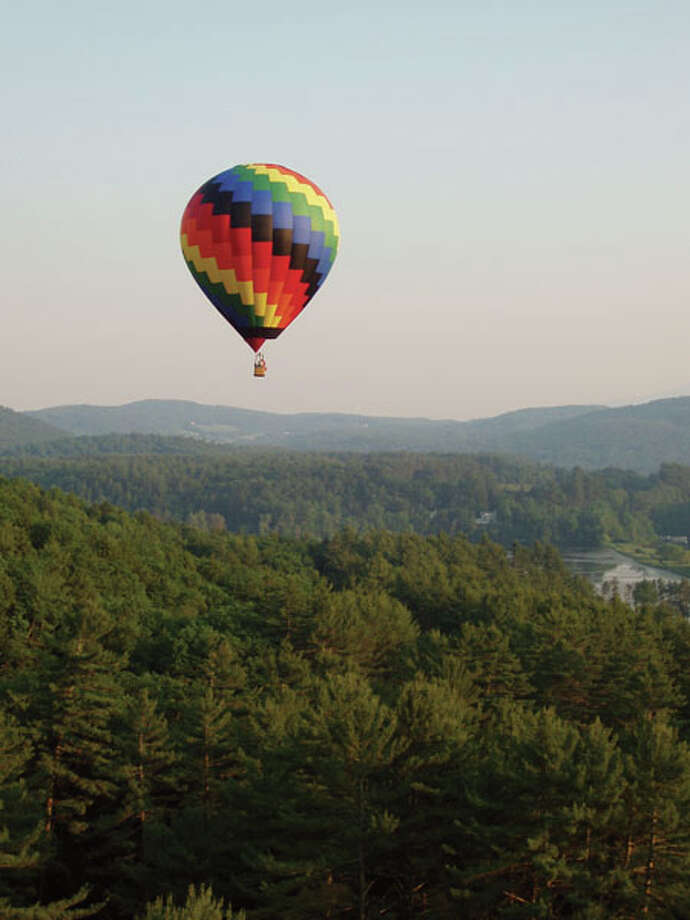Hour-long hot-air-balloon rides are facilitated through Balloons Over New England, which runs rides from the village green in Quechee, Vt. (Photo courtesy Woodstock Vermonth Chamber of Commerce)