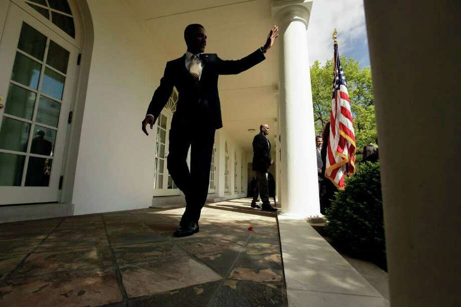 President Barack Obama waves at the White House after speaking about rising gas prices and oil company tax breaks before the Senate vote. Photo: Chip Somodevilla, Getty Images / 2012 Getty Images