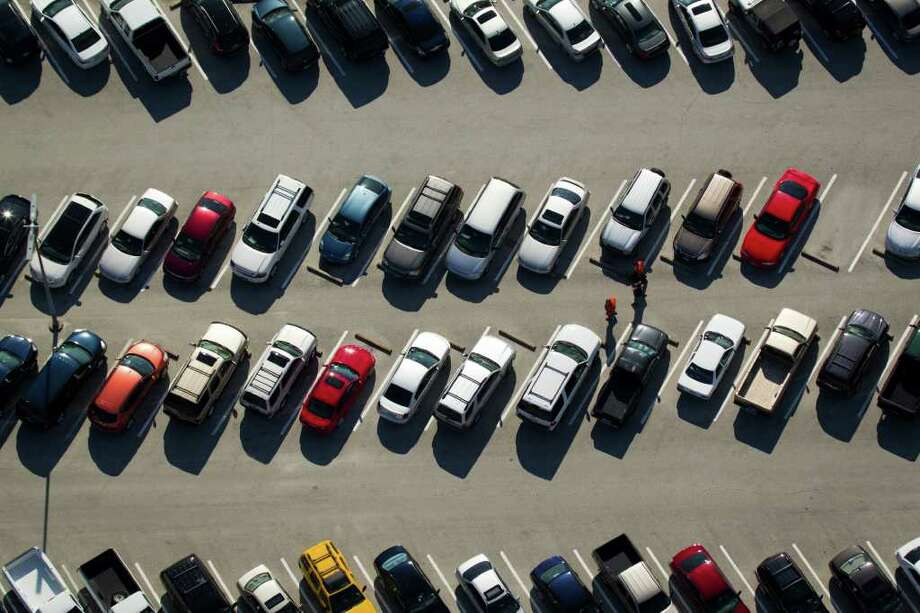 It's hard to love a parking lot. Here: Employee parking at Johnson Space Center. Photo: Smiley N. Pool / Houston Chronicle