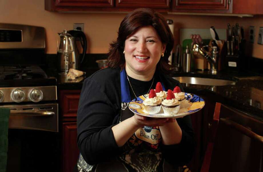 (RNS1-mar22) Amy Siegel of Clifton with her strawberry swirl peanut butter brownie cupcake that she will prepare at the Pillsbury Bake-Off.   For use with RNS-PASSOVER-PREP, transmitted March 22, 2012, RNS photo by John O'Boyle/Star-Ledger Photo: O'Boyle, John / RNS-PASSOVER-PREP