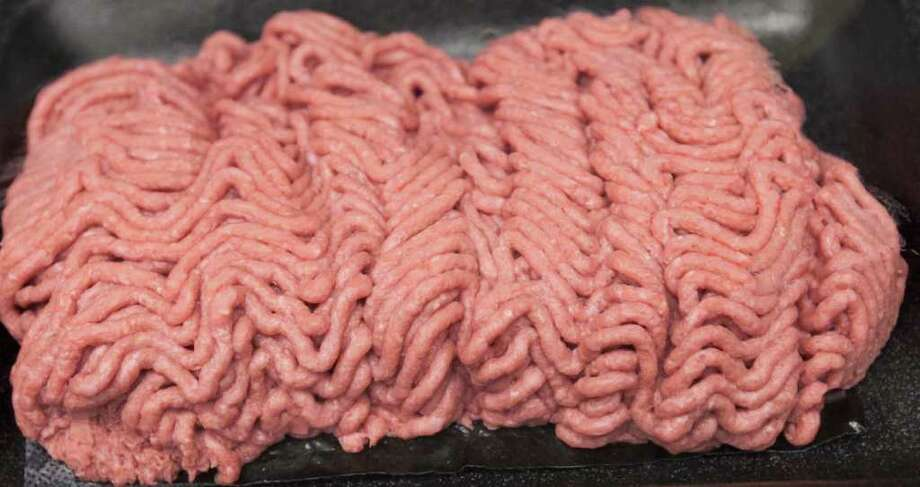 The beef product known as pink slime or lean finely textured beef is displayed on a tray during a tour Thursday, March 29, 2012, of the Beef Products Inc.'s plant in South Sioux City, Neb., where the product is made. The governors of Iowa, Texas and Kansas and lieutenant governors of Nebraska and South Dakota toured the plant to show their support for the company and the several thousand jobs it creates in Nebraska, Iowa, Kansas, South Dakota and Texas. Photo: Nati Harnik, Associated Press