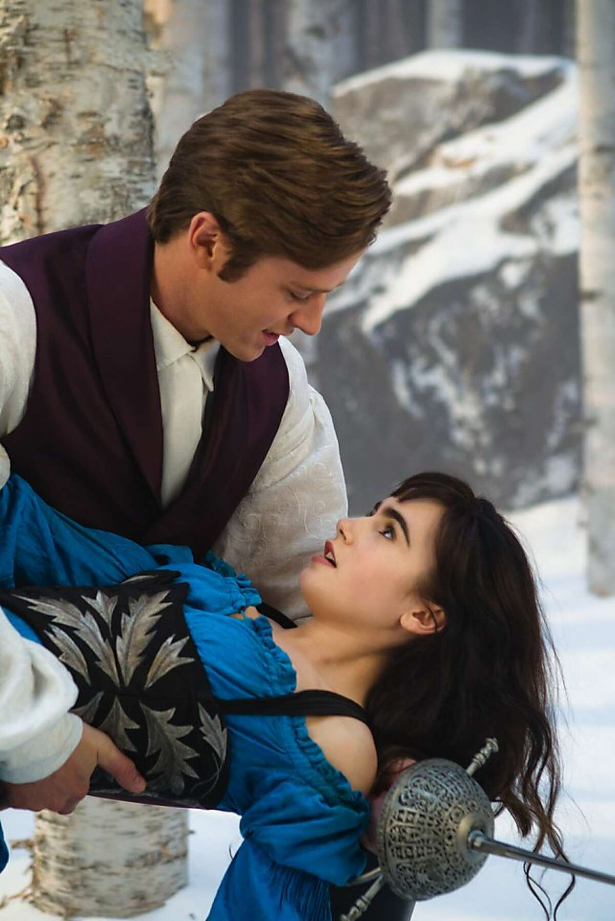 """In this film image released by Relativity Media, Armie Hammer and Lily Collins are shown in a scene from, """"Mirror Mirror."""" (AP Photo/Relativity Media, Jan Thijs)"""
