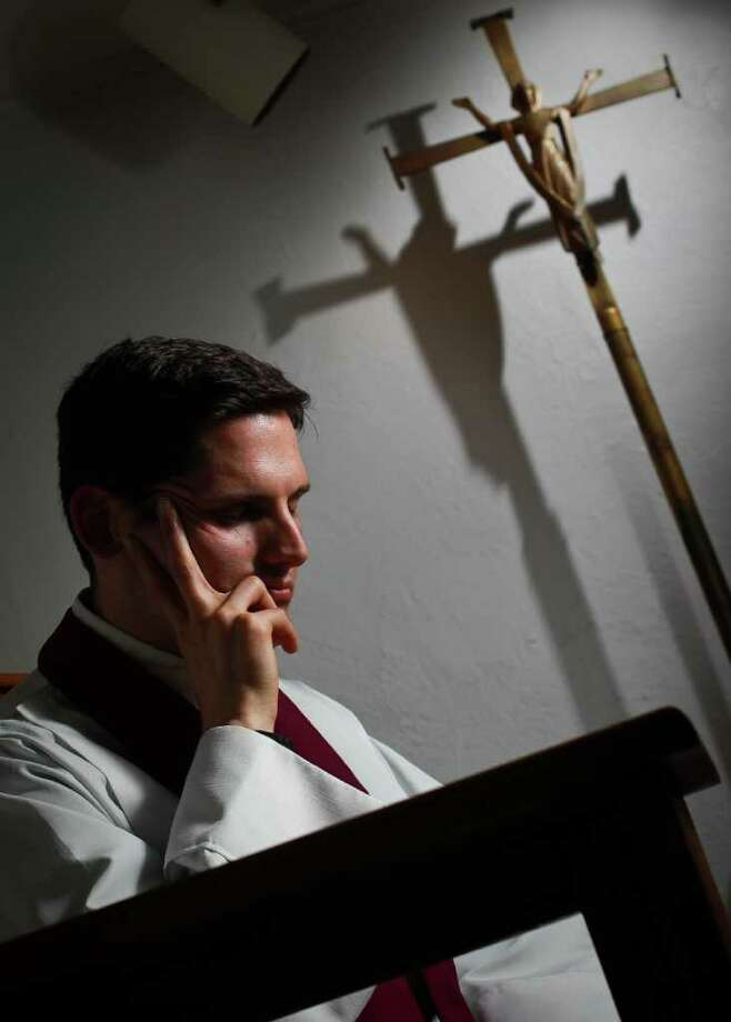 Father Christopher Plant of Resurrection Catholic Church in his confessional booth, Tuesday, March 27, 2012, in Houston.  ( Nick de la Torre / Houston Chronicle ) Photo: Nick De La Torre / © 2012  Houston Chronicle