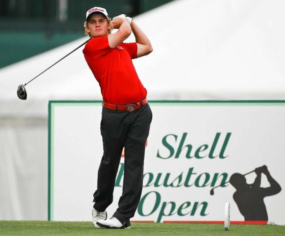 Bud Cauley, of Jacksonville, Fla., tees off at the 17th hole during the first round. (Nick de la Torre / Houston Chronicle)