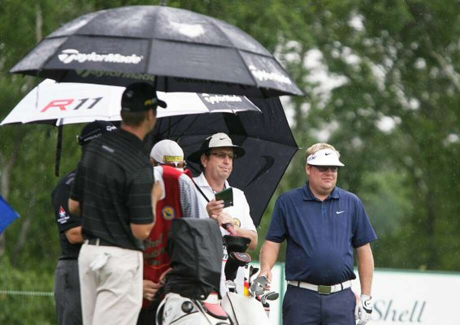 Carl Pettersson, right, waits for a chance to continue his round. He finished 7-under with a share of the lead. (Nick de la Torre / Houston Chronicle)
