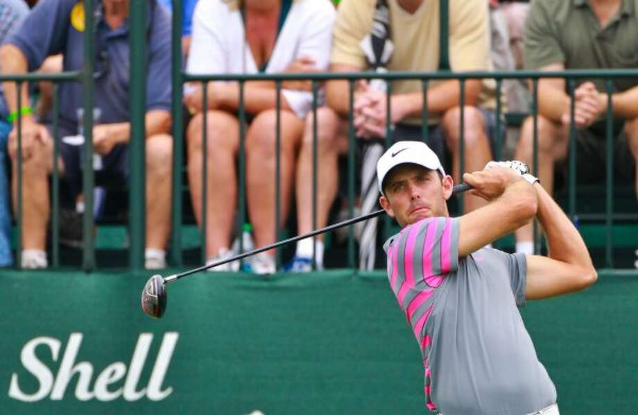 Charl Schwartzel, of South Africa, tees off at the first hole. (Nick de la Torre / Houston Chronicle)