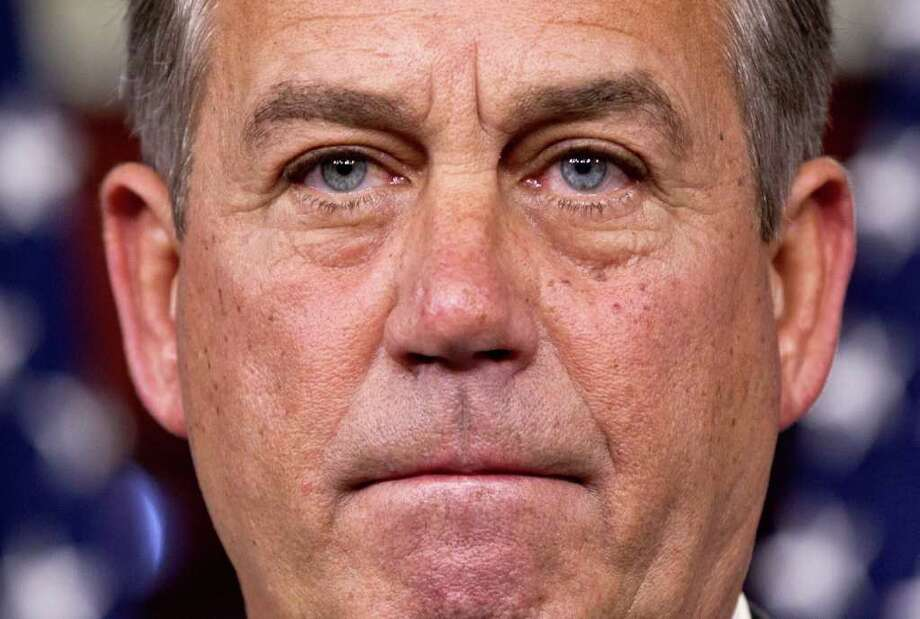 House Speaker John Boehner of Ohio takes questions during a news conference on Capitol Hill in Washington, Thursday, March 29, 2012.  (AP Photo/J. Scott Applewhite) Photo: J. Scott Applewhite