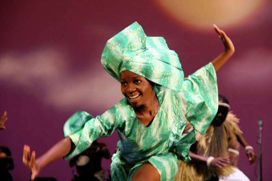 Spirit of Uganda's Betty Nakato performs in one of the dance troupe's shows. The troupe will perform Sunday, April 1, at the Quick Center. Photo: Contributed Photo