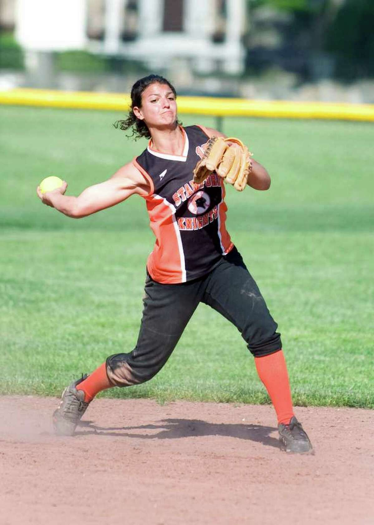 Stamford High School's Krista Robustelli makes a throw to first against Shelton High School during softball CIAC Class LL game in Stamford, Conn. on Tuesday May 31, 2011. Stamford won 9-3.