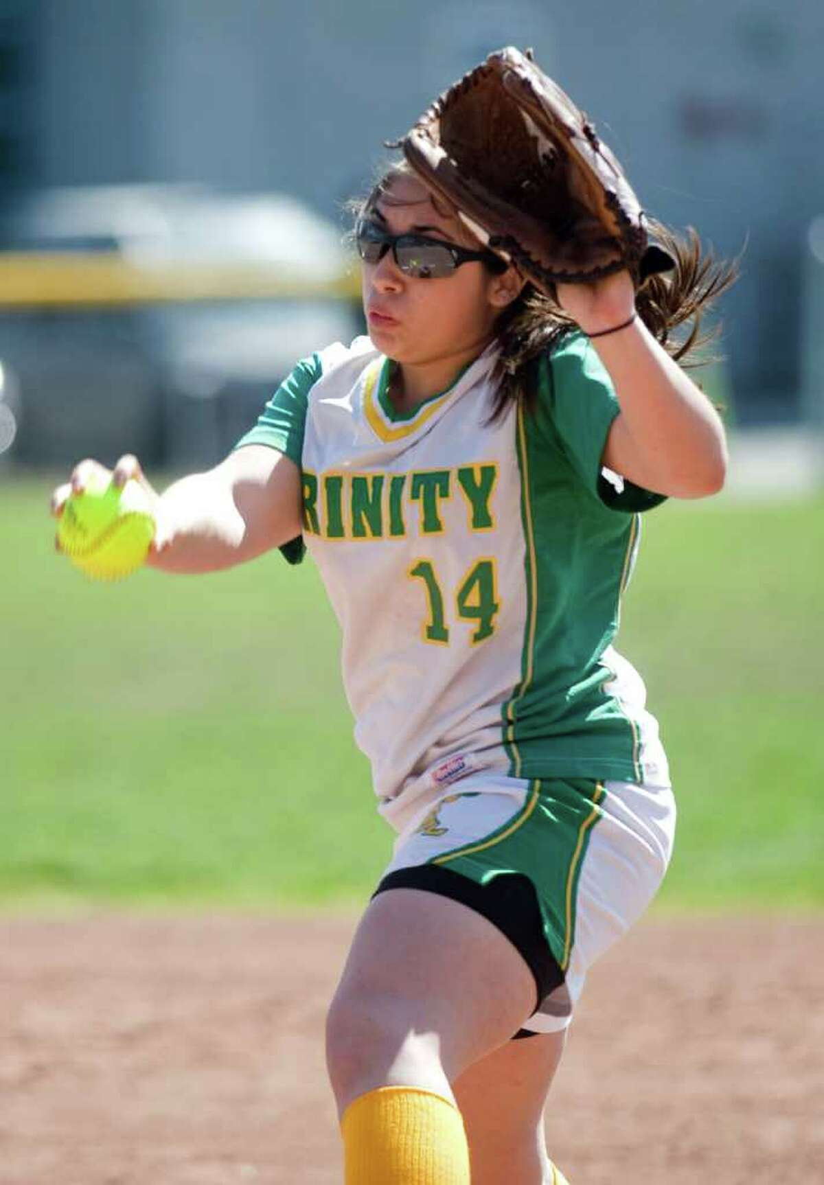 Trinity Catholic's Krissy Schule delivers to the plate against Westhill in softball action in Stamford, Conn. on Saturday April 9, 2011. Westhill won 6-0.