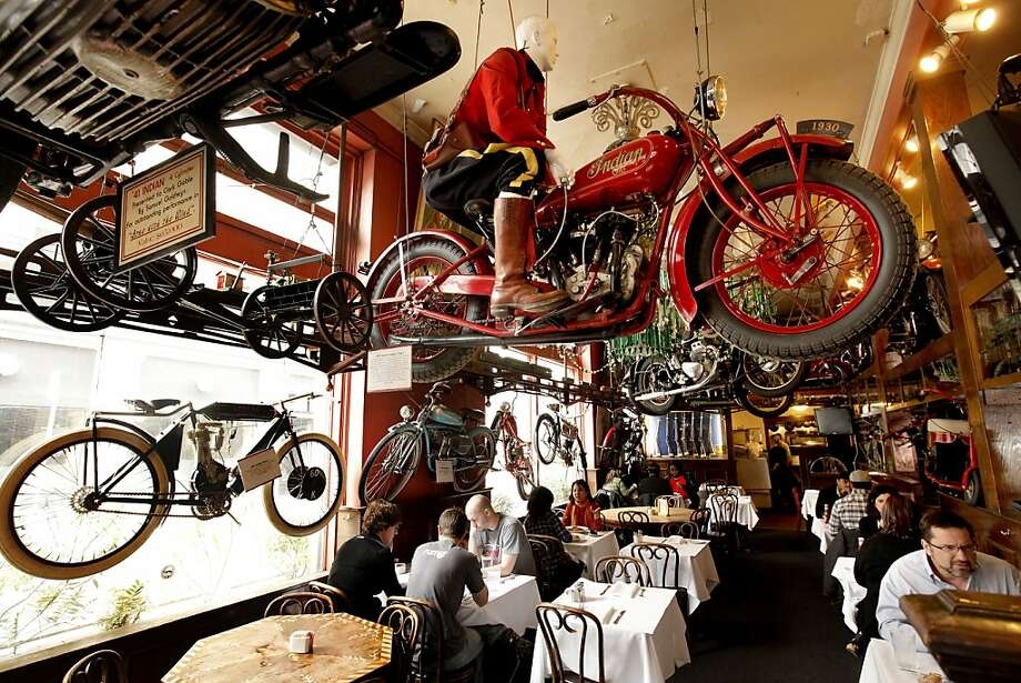 The dining area of Eddie Rickenbackers on Thursday March 29, 2012, in San Francisco, Ca. The popular bar is known for it's unusual decor of vintage motorcycles hanging from the ceiling and original Tiffany lamps lining the bar. Now all six lamps and one Tiffany chandelier are headed for Christie's auction house in New York, where they are expected to fetch more than $2 million. Photo: Michael Macor, The Chronicle