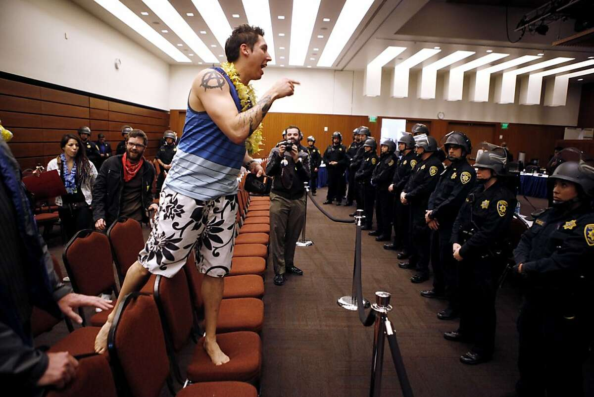 UCLA student Matthew Sandoval yells at University of California Police after UC Regents suspended their meeting at the William J. Rutter Center on UCSF Mission Bay Campus, on Thursday, March 29, 2012 in San Francisco, Calif.