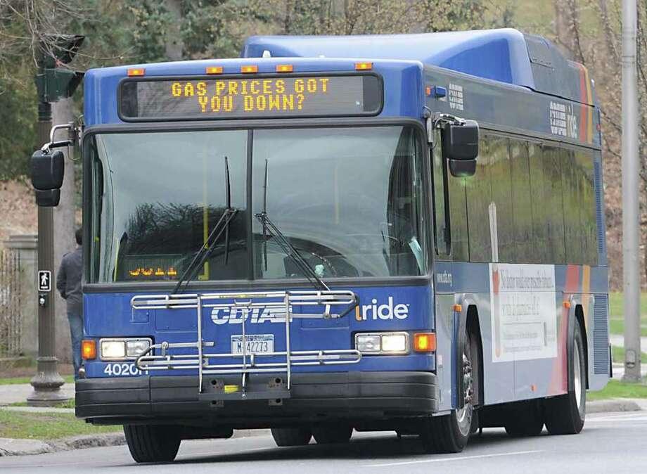 A CDTA bus rides on Broadway Thursday March 29, 2012 in Saratoga Springs, N.Y. (Lori Van Buren / Times Union) Photo: Lori Van Buren