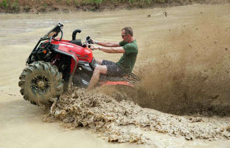 John Vicknair, of Louisiana, rides an all terrain vehicle during the High Lifter ATV Mud Nationals o