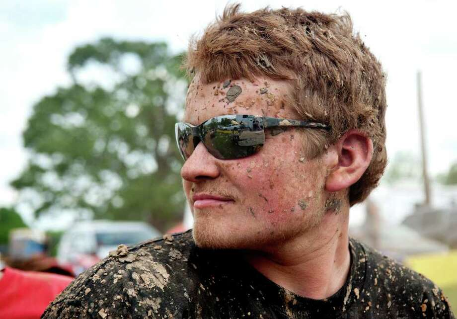 Keith Vance, of Viburnum, Mo., is covered in mud after riding his all terrain vehicle during the High Lifter ATV Mud Nationals. Photo: Sarah A. Miller, Associated Press / 2011 Sarah A. Miller / Tyler Morning Telegraph