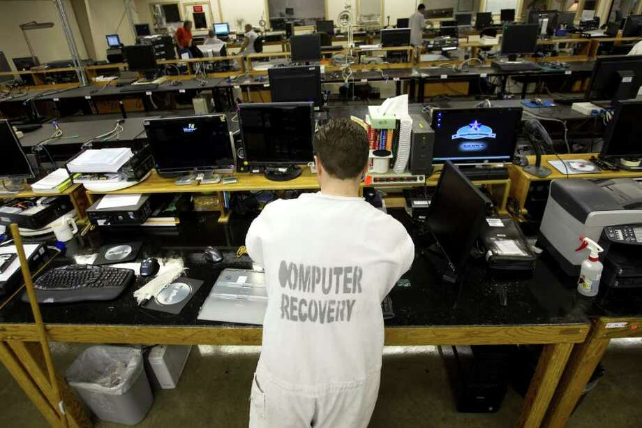 An inmate works on computers in the Computer Recovery plant at the Wynne Unit Monday, March 26, 2012, in Huntsville. Texas Correctional Industries provides a variety of goods for use throughout the Texas Department of Criminal Justice and other state agencies. There are 5,200 inmates assigned to TCI in 37 factories statewide. Photo: Brett Coomer, Houston Chronicle / © 2012 Houston Chronicle