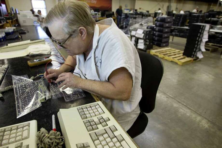 John Hargrove rebuilds keyboards in the Computer Recovery plant at the Wynne Unit Monday, March 26, 2012, in Huntsville. Texas Correctional Industries provides a variety of goods for use throughout the Texas Department of Criminal Justice and other state agencies. There are 5,200 inmates assigned to TCI in 37 factories statewide. Photo: Brett Coomer, Houston Chronicle / © 2012 Houston Chronicle