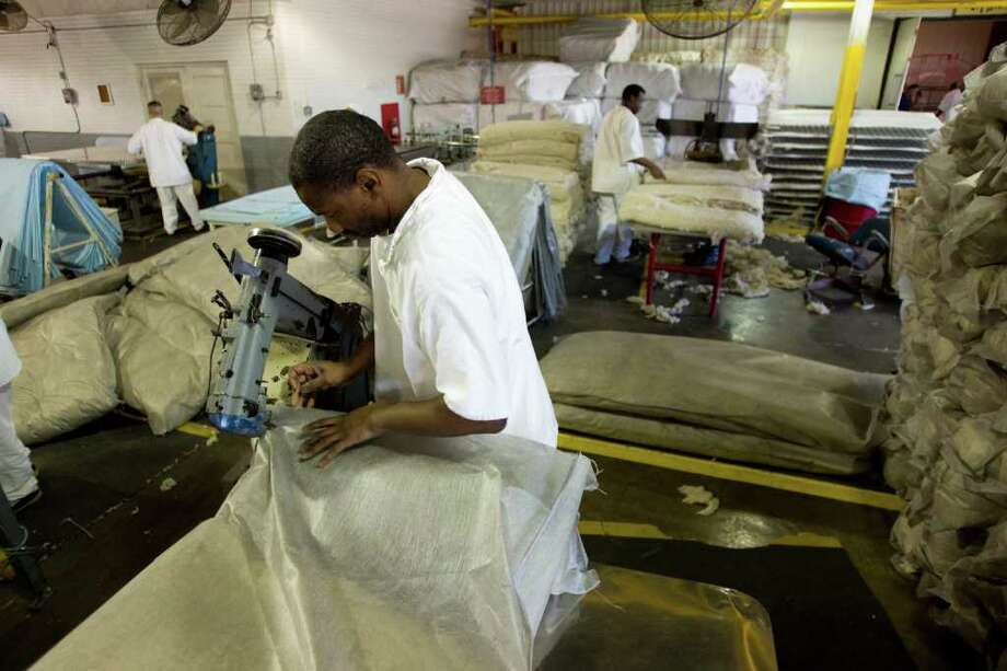 Cedric Brown sews up a mattress at the Wynne Unit mattress factory Monday, March 26, 2012, in Huntsville. Texas Correctional Industries provides a variety of goods for use throughout the Texas Department of Criminal Justice and other state agencies. There are 5,200 inmates assigned to TCI in 37 factories statewide. Photo: Brett Coomer, Houston Chronicle / © 2012 Houston Chronicle
