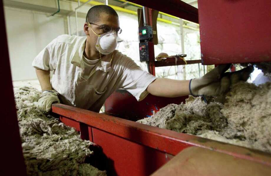 Dean Johnson sorts virgin cotton at the Wynne Unit mattress factory Monday, March 26, 2012, in Huntsville. Photo: Brett Coomer, Houston Chronicle / © 2012 Houston Chronicle